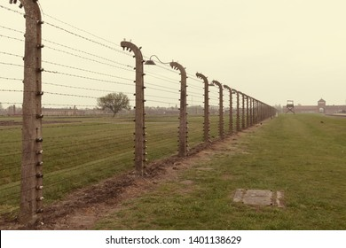 Oswiecim (Auschwitz Birkenau), Poland - May 9th. 2019: Barbed wire fences with high voltage in Auschwitz, the biggest nazi concentration camp in Europe during the holocaust.