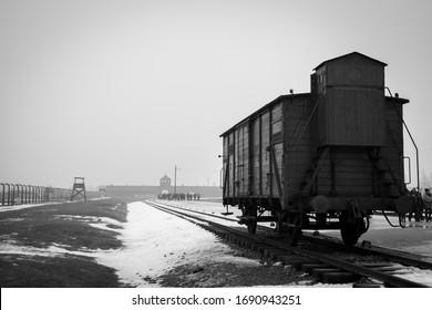 Oswiecim, Poland - 02/04/2017: Holocaust transport train in Auschwitz II - Birkenau main extermination camp for jews during holocaust in snowy winter, Poland