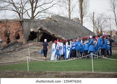Oswiecim, Poland - 12 April 2018: International Holocaust Remembrance Day. Thousands of judes come to Auschwitz to join The March of the Living in concetration camp. Group of Jews at the crematorium.