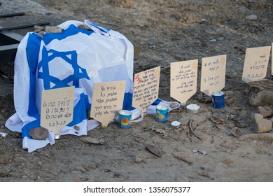 Oswiecim, Poland - 12 April 2018: International Holocaust Remembrance Day. Thousands of judes with Israeli flag come to Auschwitz to join and pray The March of the Living. Cards placed on the tracks
