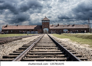 Oswiecim, Poland - April 7, 2018: Auschwitz Birkenau Gate Rail Entrance German Nazi Concentration and Extermination Camp in World War Two, Poland