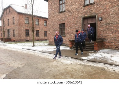 OSWIECIM, POLAND - JANUARY 27, 2016: Members of the Croatian Handball team that participates in Euro Handbal 2016 durning their visit of the former Auschwitz I camp