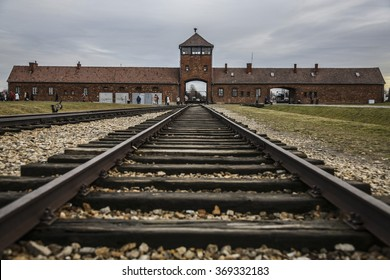 OSWIECIM, POLAND - JANUARY 27, 2016: The Gate of Death of the former German Nazi concentration and extermination camp Auschwitz Birkenau II .
