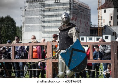 OSWIECIM, POLAND - MAY 10, 2017 ; Knight tournament. The knights in the congregations are fighting in the ring. Public event in the city. Soldiers in armor of the Middle Ages.
