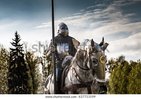 OSWIECIM, POLAND - MAY 10, 2017 ; Knight on horseback. Horse in armor with knight holding lance. Horses on the medieval battlefield.