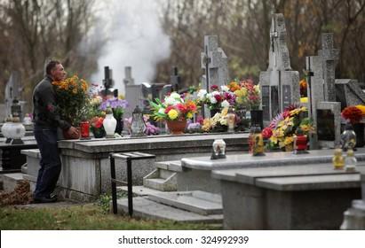 OSWIECIM, POLAND - NOVEMBER 1, 2013: Graves in autumn.  Municipal Cemetery in Oswiecim, Poland
