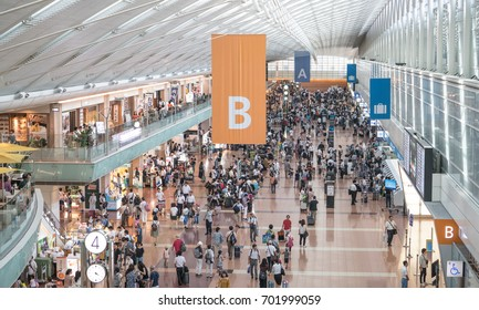 Ota, JAPAN - August 11th, 2017: Busy travelers in Haneda Airport Terminal 2 during the Obon holiday season, one of the busiest travel times of the year in Japan.