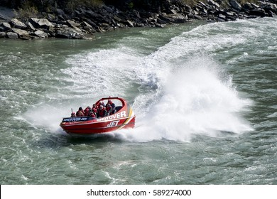 OTAGO, NEW ZEALAND - SEPTEMBER 6, 2016: The jet boat ride, Shotover Jet is the ultimate thrill ride of a lifetime in water sports and has been thrilling millions of people since 1965