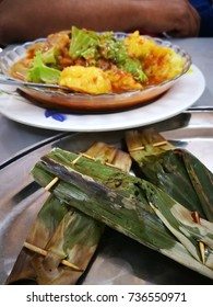 Otak - otak and the Popular Mi Rebus (Boiled Noodles) in Malaysia and neighbourhood country Singapore and Indonesia served in plates.
