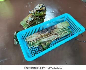 'Otak-otak' and 'Satar' inside the blue basket. Malaysian cuisine and Terengganu traditional food.