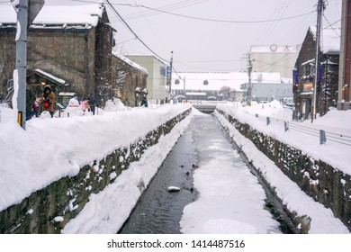 Otaru, Hokkaido, Japan 14 February 2018 : Landscape view of Otaru canal with snow covered and building on heavy snow day. Otaru canal is an important landmark, located in the center of Otaru city.