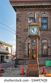 Otaru, Hokkaido, Japan- December 12, 2015. The vintage steam clock tower in front of Otaru Music Box Museum. The steam clock was made by Canadian clock maker Raymond Sounders in 1977.