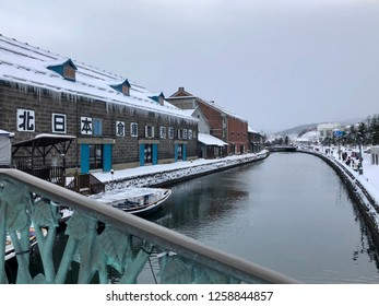 OTARU, HOKKAIDO, JAPAN -December 8 2018: The view of historic Otaru canal in winter with snow cover. The Otaru Canal is a popular destination for Japanese and foreign visitors.