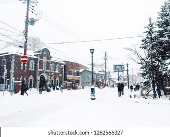 Otaru Hokkaido/ Japan - December 8, 2018 : People walking around Otaru town in the snow winter at Hokkaido Japan