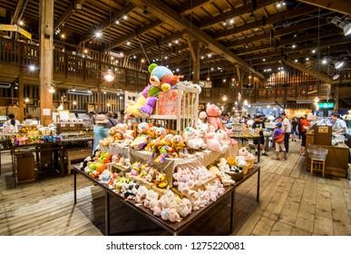 Otaru, Hokkaido/ Japan - July 29, 2018:  Bunch of dolls on a table in Otaru Music Box Museum or Otaru Music Orgel.
