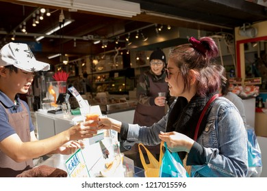 otaru hokkaido japan - october7,2018 : asian tourist buying hokkaido melon in otaru street,otaru is one of most popular traveling destination in hokkaido