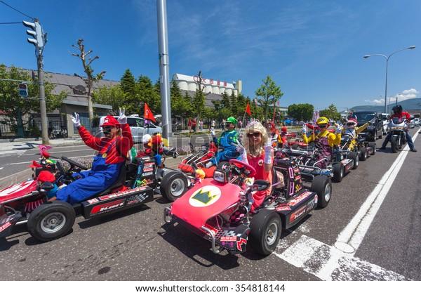 OTARU, JAPAN - 22 JUNE 2015 : real Mario Kart on street
