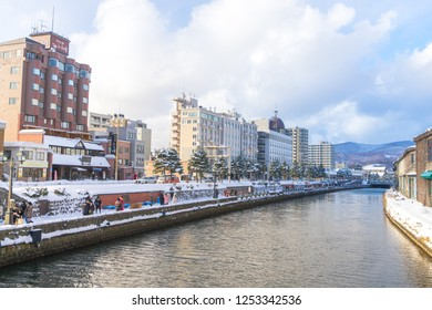 OTARU JAPAN - December 9 2018 : View of tourism visiting in Otaru historic canal in winter with snow cover. The Otaru Canal is a popular tourist destination for Japanese and foreign visitors.