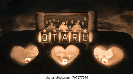 OTARU, JAPAN - FEBRUARY 8, 2017 - Decorated snow sculpture at entrance to the Otaru Snow Light Path Festival. The festival is held every February and typically coincides with the Sapporo Snow Festival