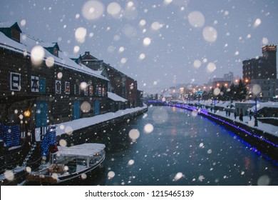Otaru, Japan - JANUARY 4, 2018 : Snow storm at Otaru Canal in Winter. The Otaru Canal is a popular tourist destination for Japanese and foreign visitors who see the romantic scene image with snow.