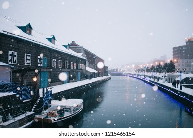 Otaru, Japan - JANUARY 4, 2018 : Snow falling at Otaru Canal in Winter. The Otaru Canal is a popular tourist destination for Japanese and foreign visitors who see the romantic scene image with snow.