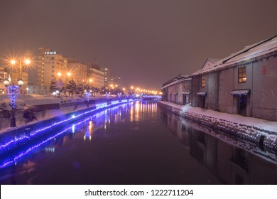 Otaru, Japan - JANUARY 4, 2018 : Beautiful view of Otaru canal in Winter. The Otaru Canal is a popular tourist destination for Japanese and foreign visitors to see the romantic scene image with snow.