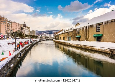 Otaru, Japan winter skyline on the canals.