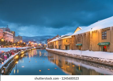 Otaru, Japan winter skyline on the canals during the twilight light up.