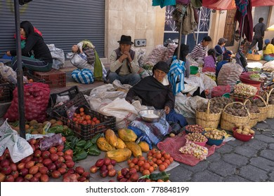Otavalo, Ecuador - December 16, 2017: indigenous people selling produce in the Saturday farmers market