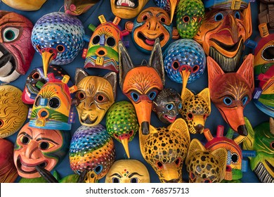 Otavalo, Ecuador - December 2, 2017: closeup of colourful indigenous wood carvings in the Saturday artisan market