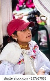 OTAVALO, ECUADOR - JAN 3, 2015: Unidentified Ecuadorian girl at the Otavalo Market. 71,9% of Ecuadorian people belong to the Mestizo ethnic group