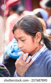 OTAVALO, ECUADOR - JAN 3, 2015: Unidentified Ecuadorian girl at the Otavalo Market. 71,9% of Ecuadorian people belong to the Mestizo ethnic group