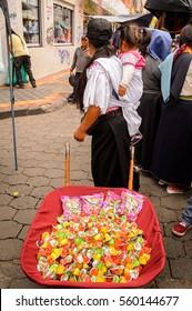 OTAVALO, ECUADOR - JAN 3, 2015: Unidentified Ecuadorian people at the Otavalo Market. 71,9% of Ecuadorian people belong to the Mestizo ethnic group