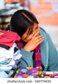 OTAVALO, ECUADOR - JAN 3, 2015: Unidentified Ecuadorian woman in traditional clothes works at the Otavalo Market. 71,9% of Ecuadorian people belong to the Mestizo ethnic group