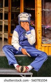 OTAVALO, ECUADOR - JAN 3, 2015: Unidentified Ecuadorian boy works at the Otavalo Market. 71,9% of Ecuadorian people belong to the Mestizo ethnic group