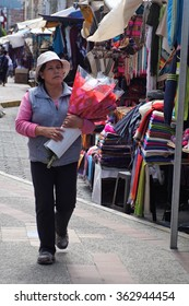 OTAVALO, ECUADOR - JANUARY 9, 2016: woman selling flowers in the market