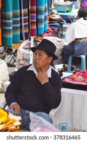 OTAVALO, ECUADOR - JANUARY 9, 2016: Man in traditional dress in the Otavalo Market