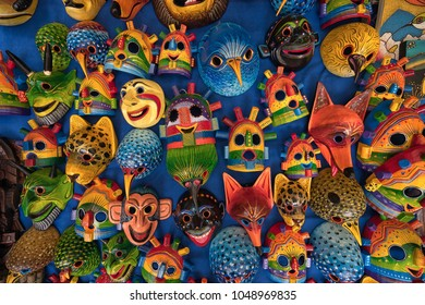Otavalo, Ecuador - March 3, 2018: closeup of colourful indigenous wood carvings for sale in the Saturday artisan market