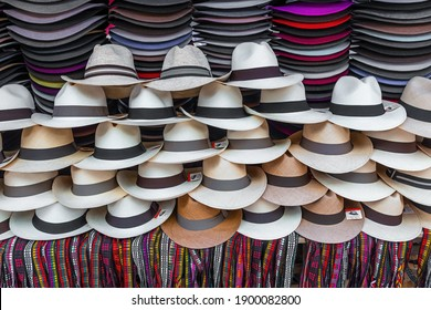 OTAVALO, ECUADOR - NOVEMBER 7, 2018: Stand with Panama hats and colorful wristbands for sale on Otavalo art and craft market.