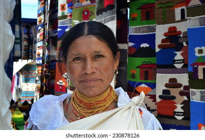 OTAVALO, ECUADOR - OCTOBER 12, 2014 : Indian women in traditional clothes sells the handcrafted goods in the market on October 12, 2014 in Otavalo, Ecuador