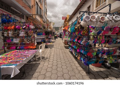 Otavalo, Ecuador-March 31,2018: vendor stands with colourful crafts set up on the street on market day