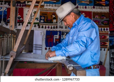 Otavalo Market, Imbabura, Ecuador. May, 19th 2018. Artisan workshop for the production of indigenous fabrics from the Andean Quichua culture. A man using a wooden loom. Illustrative image