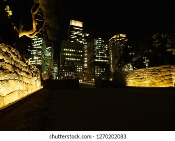 OTEMACHI, TOKYO / JAPAN – DECEMBER 28, 2018: Wadakura-bashi bridge and the inside of stone walls which were illuminated at Wadakura-bori Moat of Imperial Palace in Japan.