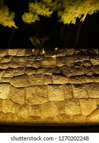 OTEMACHI, TOKYO / JAPAN – DECEMBER 28, 2018: The illuminated surface texture of stone walls at Wadakura-bori Moat of Imperial Palace in Japan.