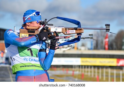Otepaa (Otepää), Estonia - MARCH 12, 2017: Yury Shopin of Russia at the shooting range in the single mixed relay at the IBU Cup Biathlon 8