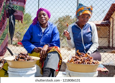 Otjiwarongo / Namibia- August 23 2016: Local women selling dried meat, biltong on the side of a street in Otjiwarongo