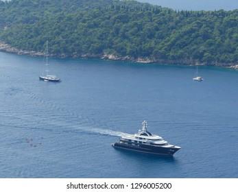 Otok Lokrum island, Croatia - August 3 2018: high panoramic view of luxury yachts around Otok Lokrum island near Dubrovnik