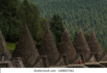Otomi Ceremonial center, Temoaya, Mexico State,Toluca / Mexico -Sep 08 2018 cones structures representing a generation of Otomis, and on each is a sculpture of Tata Jiade, the Sun