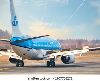 Otopeni, Romania - 01.23.2021: A KLM Royal Dutch Airlines Boeing 737-7K2 (PH-BGP) airplane on the airport runway at Henri Coanda International Airport.