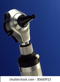 otoscope with blue backdrop